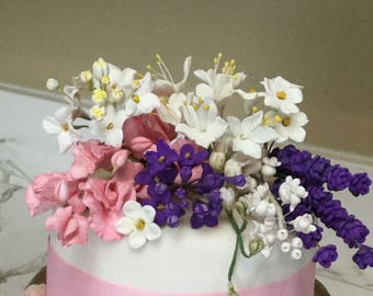 2 Ranuncullos, 2 filler flowers, 10 buds, 2 Roses, 2 Sweet Peas, 10 leaves, 1 grape  cake topper