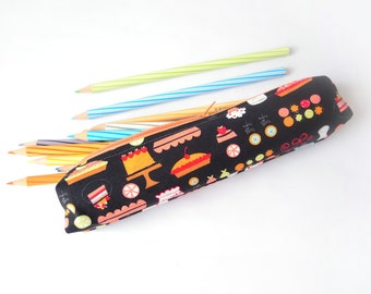 Small pencil case/zipper pouch with colourful cakes, pies and baking supplies on a black background with an orange zip