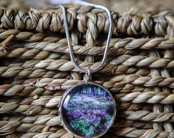 A hand crafted silver plated 20mm or 16mm pendant featuring an original photograph taken in Rothiemurchus, Scotland
