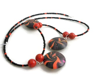 Unique long necklace red and black swirls in polymer clay