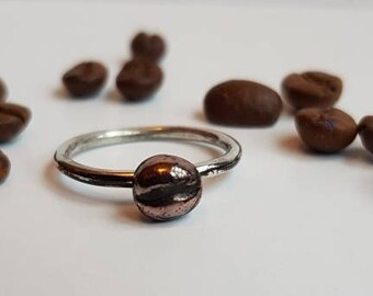 Size N coffee bean ring on sterling silver wire. The bean is made with PMC precious metal clay with copper and bronze. Stackable stacking