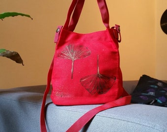 Red bag with ginkgo leaves
