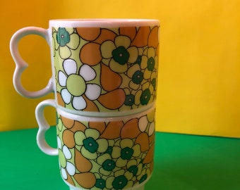 Flower power retro stacking set of two 1960s coffee mugs.