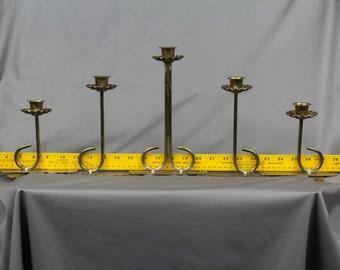 Brass folding candelabra Five candles, Brass caldelabra Accordian base Fluted wax catchers Narrow stems Looks like flowers Daffodils Vintage