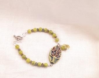 Bracelet,  Ceramic center piece, olive jasper, labradorite rondelles  pewter clasp