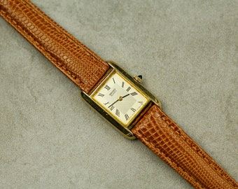 Vintage Seiko quartz watch smaller size with brown leather strap cabochon crown