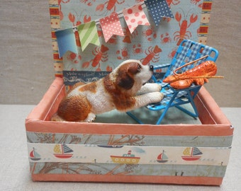 Miniature roombox - St. Bernard with lobster on beach chair