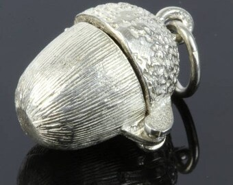Silver charm of an Acorn with squirrel inside
