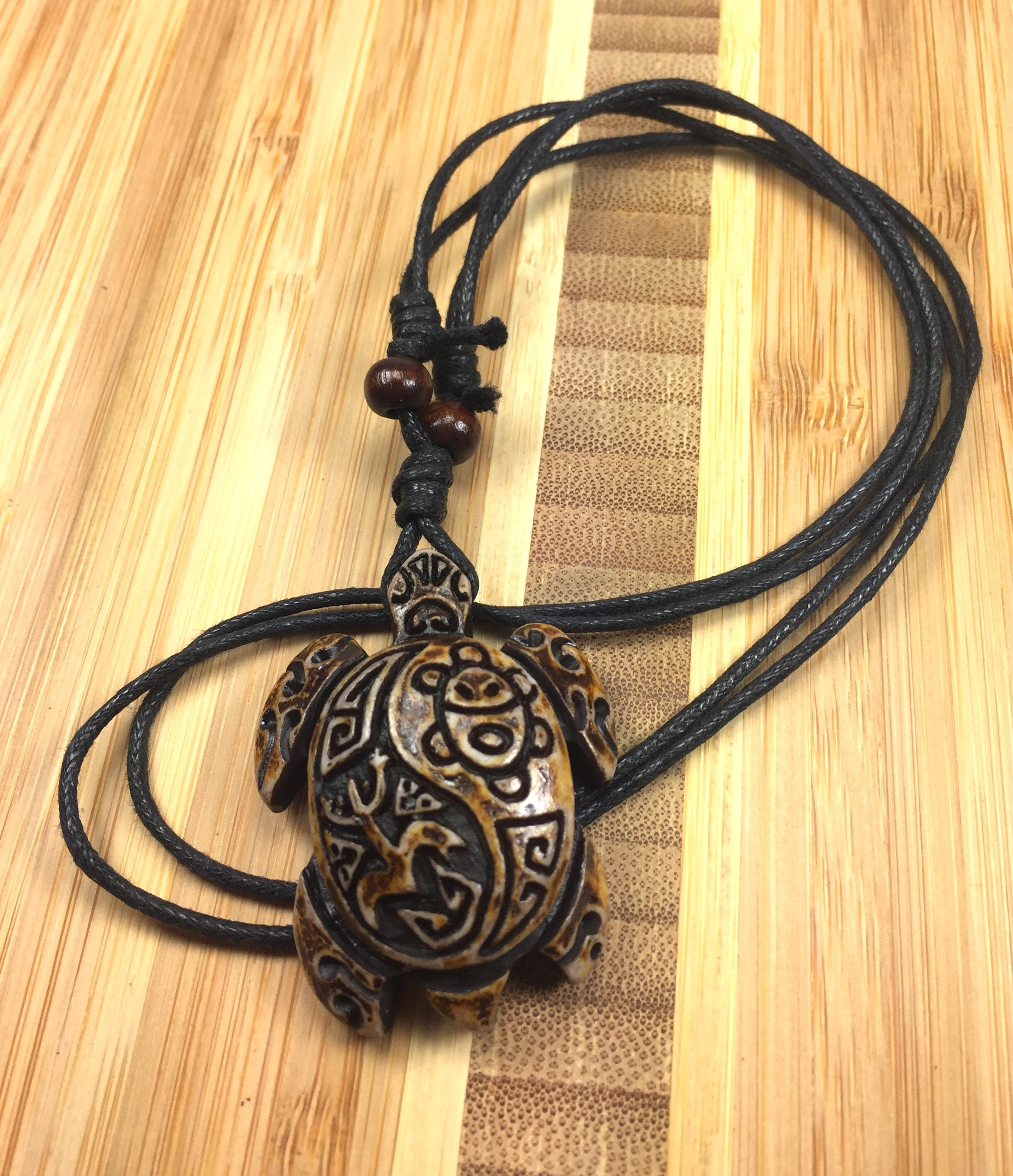 Brown turtle necklace with taino symbols engraved indian sun description brown turtle necklace with coqui taino symbol buycottarizona