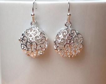 Round silver filigree earrings