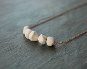 Beaded porcelain and rose gold bar necklace