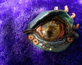 Hand-crafted teal and copper polymer clay dragon's eye pendant with handpainted glass cabochon eyeball