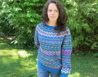 Handknit woman's teal sweater with fair isle pattern