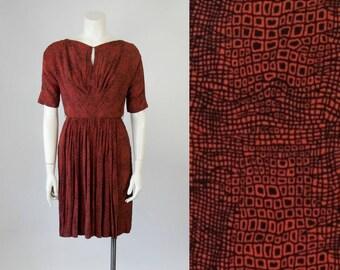 60s Vintage Black and Rust Geometric Print Rayon Dress with Swing Panel Skirt (XS - S)