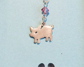 Sterling silver piglet and pink glass bead necklace.