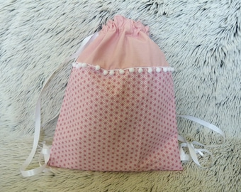 Backpack pouch lined in pink saki and tassels