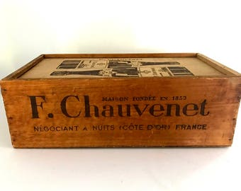 Vintage bottle carrier crate with graphics