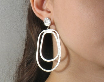 Long sterling  earrings, sleek and feminine pair of statement dangles  holding from a  nugget, surprisingly lightweight. statement earrings.