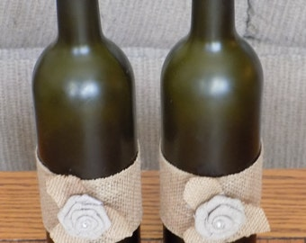 Burlap embellished wine bottle for centerpieces or home decor.