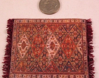 Red oriental rug carpet traditional geometric pattern red ivory and black with black fringe. 1:12 dollhouse miniature. Handmade USA.