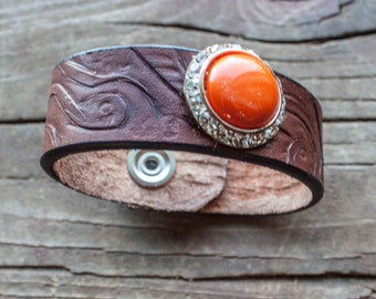Leather tooled cuff with orange stone