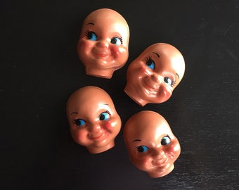 Plastic Ethnic Smiling Doll Faces w/Blue Eyes (4)
