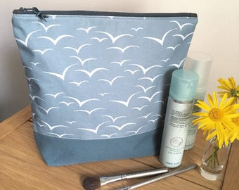 Seagull print washbag - blue/grey seagulls print - cosmetics or toiletries bag with splashproof, wipe clean lining.