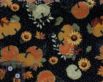 """Fall leaves and pumpkins with golden accents and dots on black   44-45"""" wide 100% cotton"""