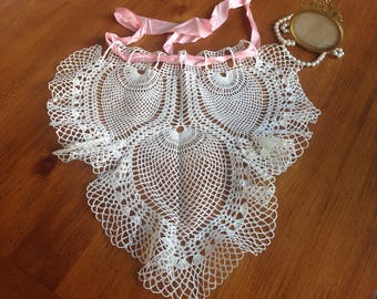 Charming vintage white crocheted apron with pink ribbon