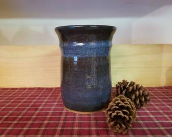 Floating blue pottery utensil 4