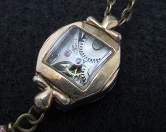 Steampunk necklace  - Glimmer - Steampunk watch parts - Repurposed Art