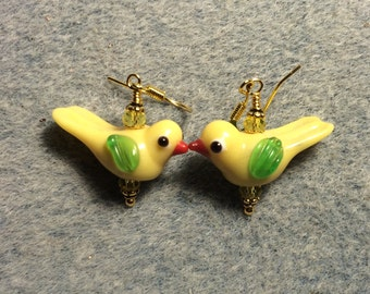 Opaque light yellow lampwork songbird bead earrings adorned with yellow Chinese crystal beads.