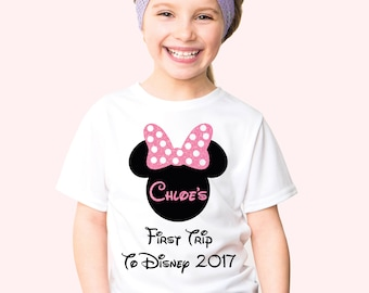Kid's customized first trip to Disney minnie mouse t-shirt with pink glitter name and bow.