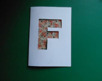 Card filled with stamp initial