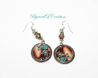 Earrings turquoise surrealist flowers on Brown background