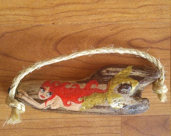 Little red haired gold tailed mermaid on driftwood