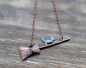 Copper pendant, witch's broom, black cat