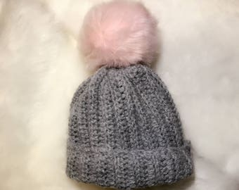 Crochet baby hat with fur pom pom