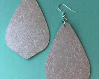 Pearl shimmer leather earrings.