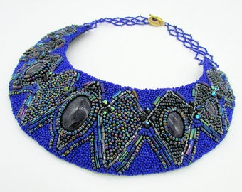 Blue goldstone bib style bead embroidered necklace