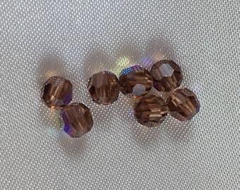 SEVEN ONLY!  Vintage Swarovski 4MM crystal beads.  Smoked Topaz AB finish