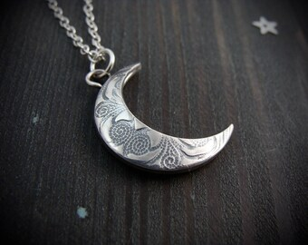 changeable moon ... reversible patterned pendant.