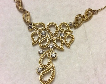 Vintage 1960's signed SAQ clear rhinestone chatelaine drop dangle gold metal necklace.