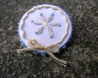 Daisy Wreath Brooch: a unique hand made mixed media upcycled brooch using hand embroidered vintage linen napkin