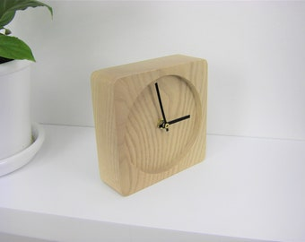 Wooden clock is placed