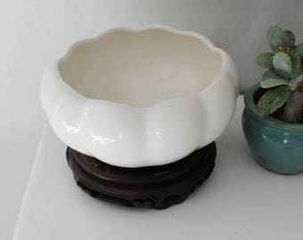 Ceramic vessel with wood stand