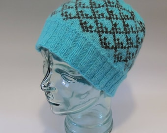 Turquoise hat with deep chocolate brown motifs