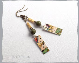 Earrings made from an ancient game of tarot.