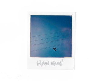 HANGING AROUND - original Polaroid instant photo print - polaroid - Power Lines - Hanging shoes