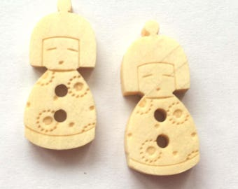 cute little button in the shape of Japanese wooden doll